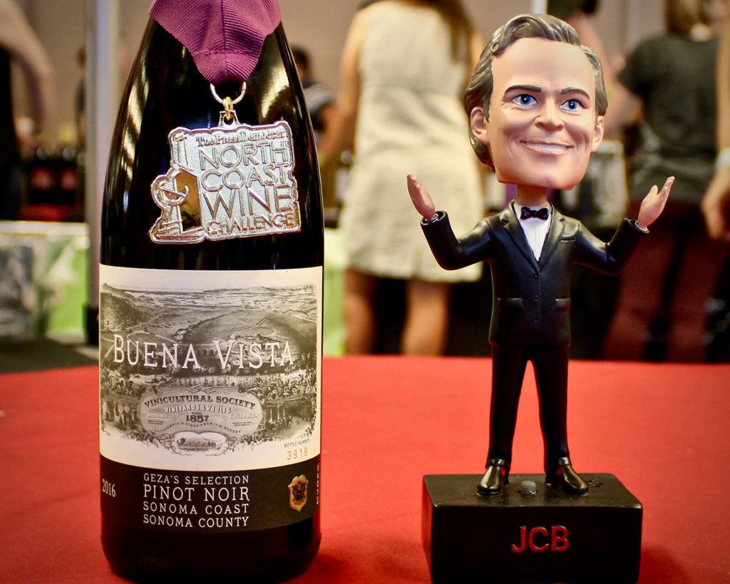 "Prize-winning Pinot and Jean-Charles Boisset bobblehead, ""Meet the Principals at Wine and Food Fest."""